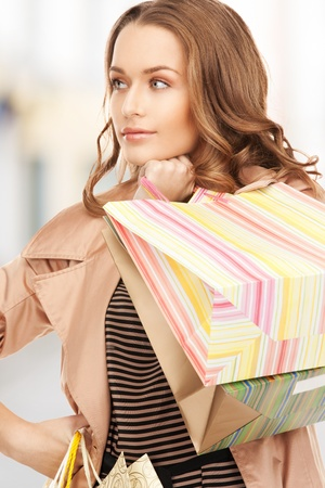 shopping and tourism concept - beautiful woman with shopping bags in ctiy Stock Photo - 21034302