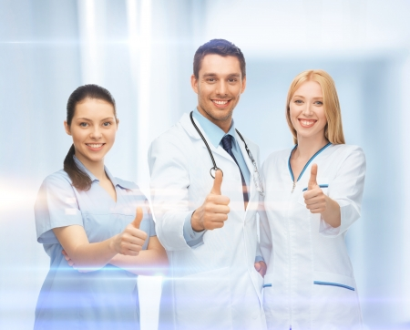 physiotherapists: healthcare and medical - professional young team or group of doctors showing thumbs up