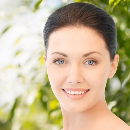 aging: beauty and eco cosmetology concept - beautiful woman on nature Stock Photo