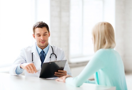 gynecologist: healthcare and medical concept - male doctor with patient in hospital