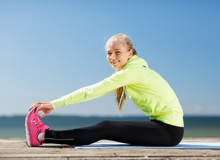 sport and lifestyle concept - woman doing sports outdoors photo