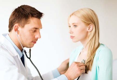 healthcare and medical - doctor with stethoscope listening to the patient in hospital photo