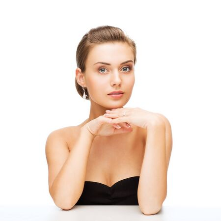 bridal makeup: beauty and jewelry - beautiful woman wearing diamond earrings and wedding ring Stock Photo