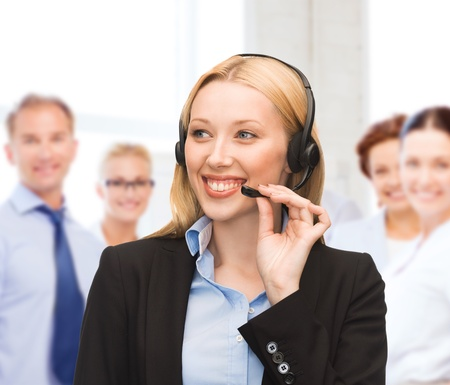 helpline: business and technology concept - helpline operator with headphones in call centre