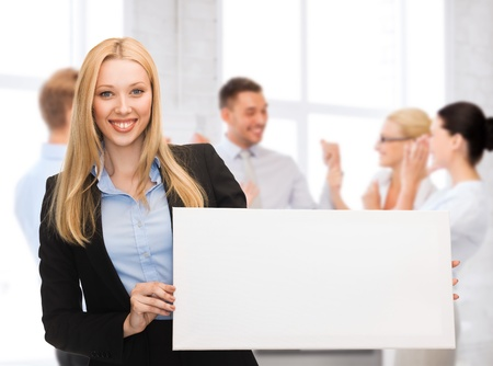 business and advertising concept - smiling businesswoman with white blank board photo