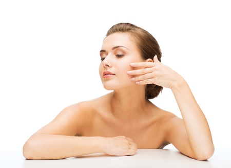 woman face: beauty concept - face and hands of beautiful woman with clean perfect skin Stock Photo