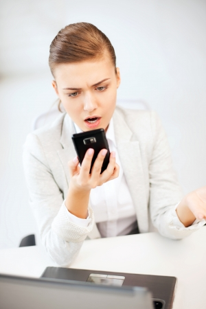 bright picture of woman shouting into smartphone Stock Photo - 21034739