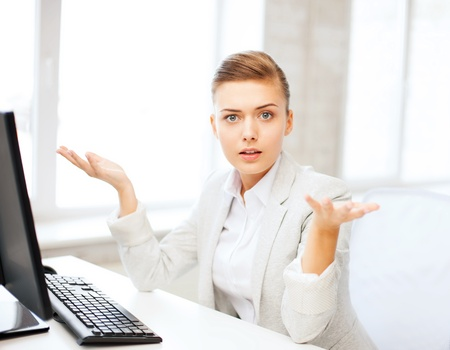 confused person: business concept - stressed businesswoman with computer in office