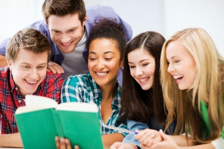 teenage girl happy: education concept - group of students reading book at school