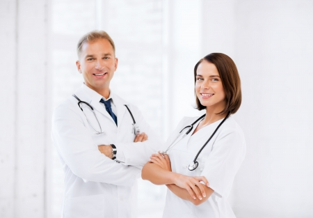 healthcare and medical concept - picture of two young attractive doctors photo