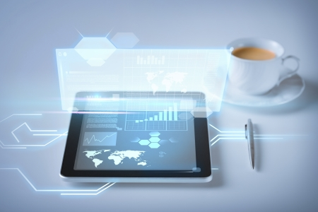 business and technology concept - tablet pc and virtual screen with cup of coffee Stock Photo - 21136462