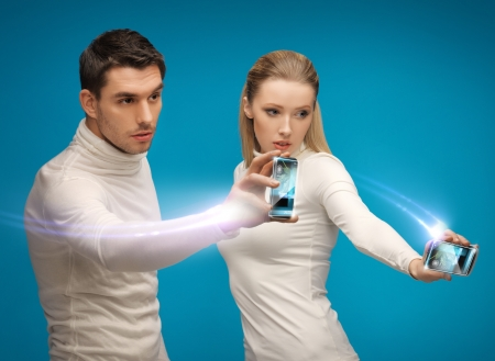 future technology and science fiction - futuristic man and woman working with gadgets photo