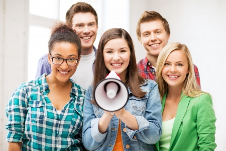 education concept - group of students with megaphone at school Stock Photo - 21136498