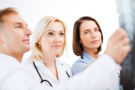 scan: healthcare, medical and radiology concept - doctors looking at x-ray