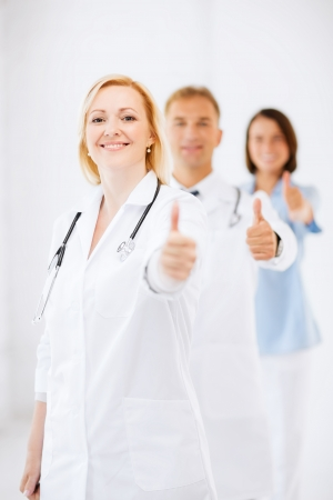 healthcare and medical concept - team of doctors showing thumbs up Stock Photo - 21136544