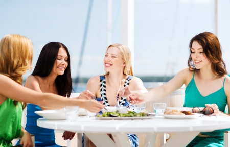 restaurant food: summer holidays and vacation - girls in cafe on the beach