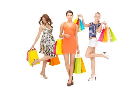 shopping, presents and gifts - attractive girls holding color shopping bags Stock Photo - 21164209