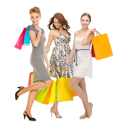 shopping, presents and gifts - attractive girls holding color shopping bags Stock Photo - 21164211