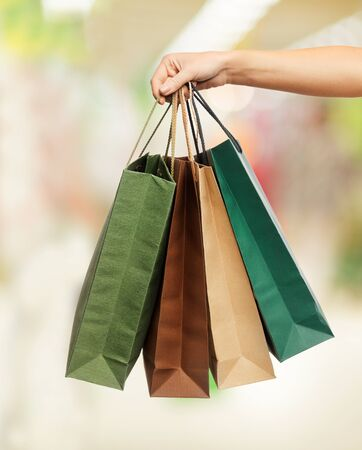 shopping - woman hand holding shopping bags in shopping center Stock Photo - 21164213