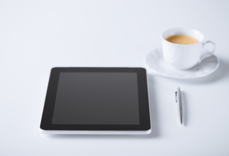 business and technology concept - tablet pc with cup of coffee Stock Photo - 21164222