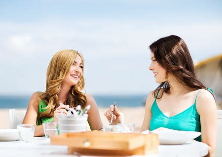 open air: summer holidays and vacation - girls in cafe on the beach