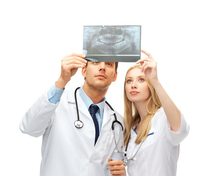healthcare and medical concept - two doctors dentists looking at x-ray photo