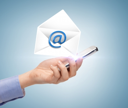 sending: business, communication and future technology - woman holding smartphone with email icon Stock Photo