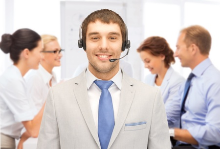 business and call center concept - helpline operator with headphones in call centre Stock Photo - 21278682