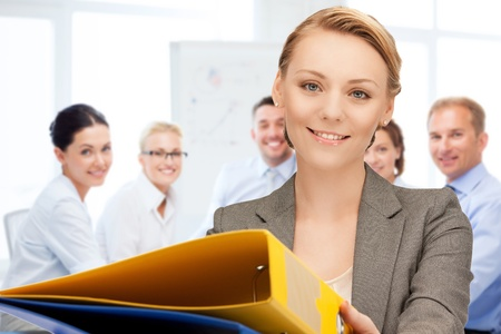 business concept - woman with folders in office photo