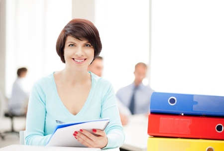 grading: business and education concept - woman with folders