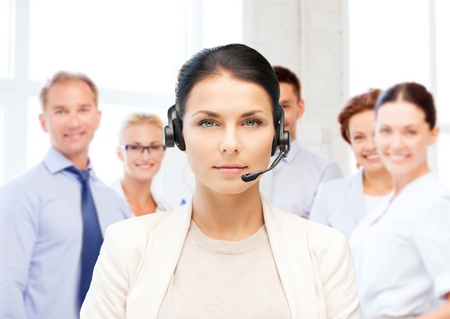 helpline: business and call center concept - helpline operator with headphones in call centre