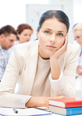 business and education concept - stressed businesswoman in office photo