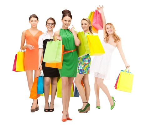 shopping, presents and gifts - attractive girls holding color shopping bags photo