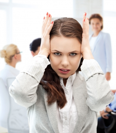 business concept - stressed businesswoman on meeting in office photo