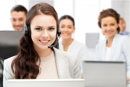 receptionist: business and technology concept - helpline operator with headphones in call centre