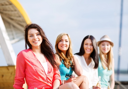 summer holidays and vacation - girls with drinks on the beach Stock Photo - 21278786