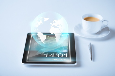 business and technology concept - tablet pc with sign of globe Stock Photo - 21221039