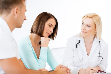 doctor's appointment: healthcare and medical concept - doctor with patients in cabinet