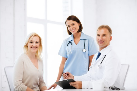 nurse clipboard: healthcare and medical concept - doctor and nurse with patient in hospital