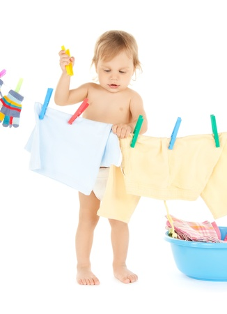 doing laundry: bright picture of adorable baby doing laundry . Stock Photo