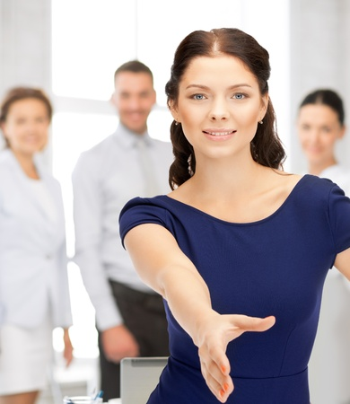 lovely woman with an open hand ready for handshake Stock Photo - 21276534