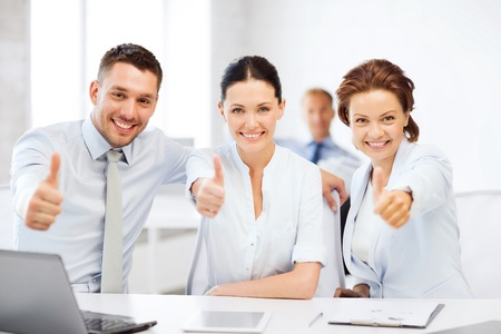 business concept - business team showing thumbs up in office Stock Photo - 21276599