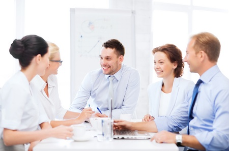 business goal: business concept - business team having meeting in office Stock Photo