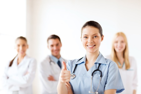 healthcare and medical concept - female doctor with group of medics showing thumbs up Stock Photo - 21276631