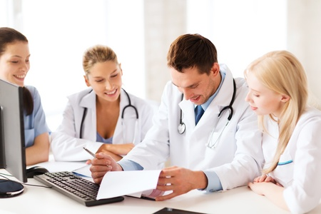 healthcare workers: healthcare and medical concept - young team or group of doctors on meeting Stock Photo