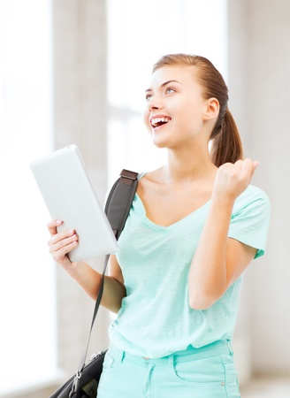 admission: education, technology and internet concept - happy student girl with tablet pc