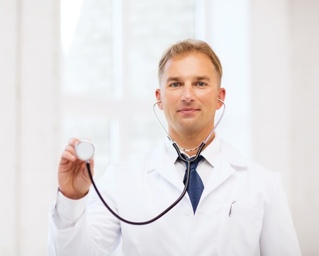 healthcare and medical concept - male doctor with stethoscope Stock Photo - 21276913