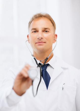 healthcare and medical concept - male doctor with stethoscope Stock Photo - 21276914