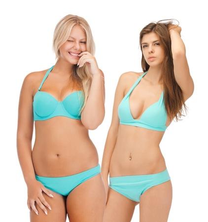summer, bikini and fashion concept - model girls in bikinis