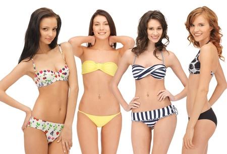 summer, bikini and fashion concept - group of model girls in bikinis